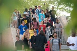 Photo of a crowd of students walking down stairs.