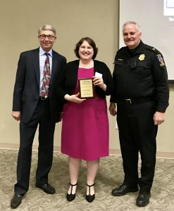 Picture of Elyse Grossman standing between two Montgomery County officials, as she holds the Montgomery County, Maryland Keeping it Safe (KIS) Community Service Award.