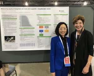Xiaobei Dong and Nancy Miller standing in front of research poster